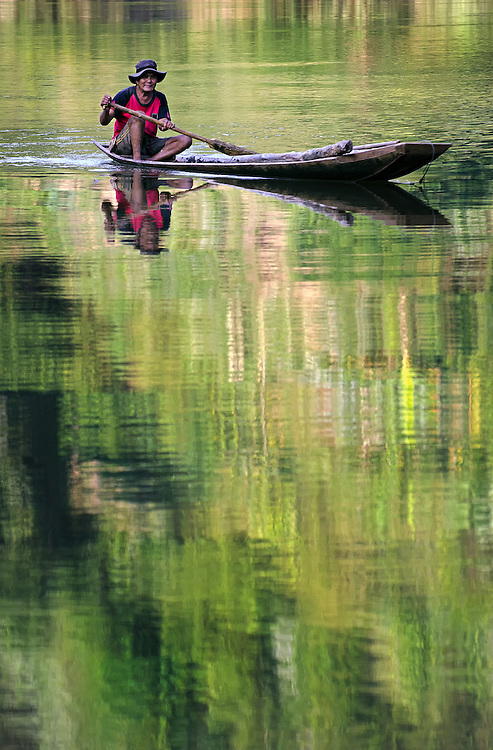 A boat at sunrise on the Nam Ou (river), Laos.