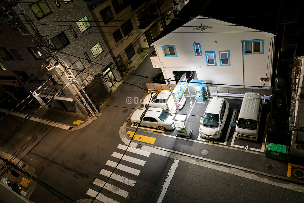 small paid parking lot at night in Yokosuka Japan