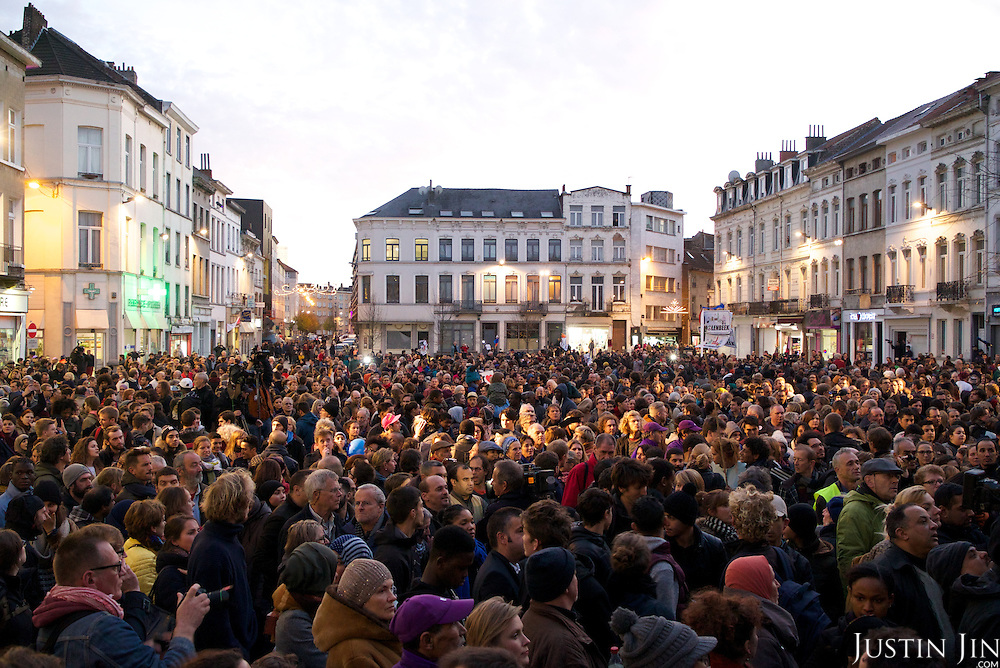 In Brussels' Molenbeek neighbourhood, participants (both white and Muslim) demonstrate of solidarity with victims of Paris attack.