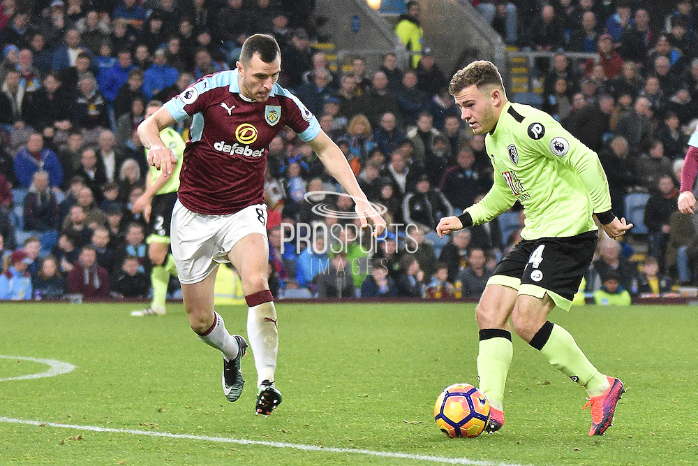 Bournemouth Midfielder, Ryan Fraser (24) and Burnley Midfielder, Dean Marney (8)  during the Premier League match between Burnley and Bournemouth at Turf Moor, Burnley, England on 10 December 2016. Photo by Mark Pollitt.