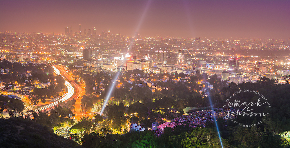 The 101 Freeway, Hollywood Bowl with searchlights & Downtown Los Angeles, California, USA