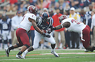Mississippi's Laquon Treadwell (1) breaks away from Troy safety Camren Hudson  (1) and Troy linebacker Mark Wilson (35\ at Vaught-Hemingway Stadium in Oxford, Miss. on Saturday, November 16, 2013. (AP Photo/Oxford Eagle, Bruce Newman)