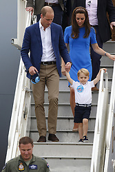 ©  London News Pictures. 08/07/2016. RAF Fairford, UK. Prince WILLIAM, CATHERINE, Duchess of Cambridge and Prince GEORGE  during a visit to the International Air Tattoo at RAF Fairford in Gloucestershire where Prince George was introduced to the Red Arrows.  Photo credit: Ian Schofield/LNP