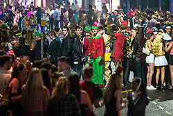 © Licensed to London News Pictures . 26/12/2018. Wigan, UK. Crowds queue outside clubs on King Street . Revellers in Wigan enjoy Boxing Day drinks and clubbing in Wigan Wallgate . In recent years a tradition has been established in which people go out wearing fancy-dress costumes on Boxing Day night . Photo credit: Joel Goodman/LNP