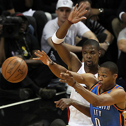 Jun 21, 2012; Miami, FL, USA; Oklahoma City Thunder point guard Russell Westbrook (0) passes the ball against Miami Heat power forward Chris Bosh (1) during the first quarter in game five in the 2012 NBA Finals at the American Airlines Arena. Mandatory Credit: Derick E. Hingle-US PRESSWIRE