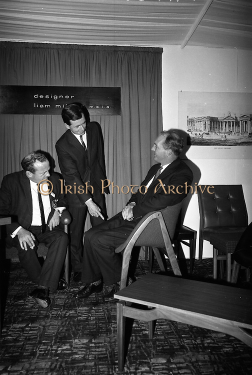 Irish Furniture Fair..1966..27.09.1966..09.27.1966..27th September 1966..Today saw the opening of the Irish Furniture Fair at the Intercontinental Hotel in Dublin. The fair is to promote the quality and value of furniture manufactured within Ireland...Image shows the Minister for Industry and Commerce, Mr George Colley TD, trying out a chair designed by Liam Milner.