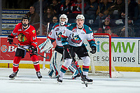 KELOWNA, CANADA - MARCH 3:  Jake Gricius #14 of the Portland Winterhawks looks for the pass while checked by Dalton Gally #3 in front of the net of Roman Basran #30 of the Kelowna Rockets on March 3, 2019 at Prospera Place in Kelowna, British Columbia, Canada.  (Photo by Marissa Baecker/Shoot the Breeze)