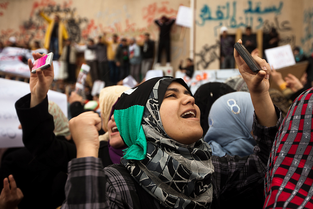 A girl chants while recording the scene with her cell phone during an anti-Qadaffi rally on February 25, 2011.