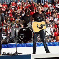 Grammy nominated country music star Dierks Bentley performs during halftime of the NCAA  Capital One Bowl football game between the Georgia Bulldogs and the Nebraska Cornhuskers, at the Florida Citrus Bowl on Tuesday, January 1, 2013 in Orlando, Florida. (AP Photo/Alex Menendez)