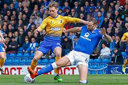Ian Evatt of Chesterfield sticks a leg out to tackle Danny Rose of Mansfield Town - Mandatory by-line: Ryan Crockett/JMP - 14/04/2018 - FOOTBALL - Proact Stadium - Chesterfield, England - Chesterfield v Mansfield Town - Sky Bet League Two