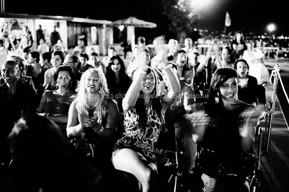San Sebastiano al Vesuvio, Italia - 28 luglio 2011. Trans tra il pubblico del concorso di bellezza Miss Trans Campania 2001 tifano per le transessuali in concorso..Ph. Roberto Salomone Ag. Controluce.ITALY - Spectators cheer during Miss Trans Campania 2011 beauty contest in San Sebastiano al Vesuvio on July 28, 2011.