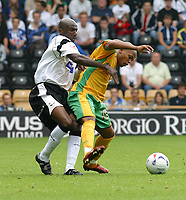 Photo: Dave Linney.<br />Derby County v Norwich City. Coca Cola Championship. 19/08/2006.Norwich's Rob Earnshaw(R) shields the ball away from  Michael Johnson
