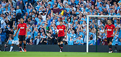 22.09.2013, Etihad Stadion, Manchester, ENG, Premier League, Manchester City vs Manchester United, 5. Runde, im Bild Manchester United's Michael Carrick walks back to the centre circle dejected as Manchester City score the fourth goal during the English Premier League 5th round match between Manchester City and Manchester United at the Etihad Stadium, Manchester, Great Britain on 2013/09/22. EXPA Pictures © 2013, PhotoCredit: EXPA/ Propagandaphoto/ David Rawcliffe<br /> <br /> ***** ATTENTION - OUT OF ENG, GBR, UK *****