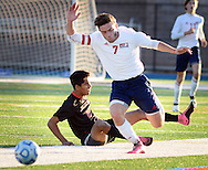 Newark Academy's Kiran Damodaran #2 trips up Moorestown Friend's Matthew Mullock #7 in the first half of the non-public B boys soccer state championship game Sunday November 15, 2015 at Kean University in Union, New Jersey. (Photo by William Thomas Cain)