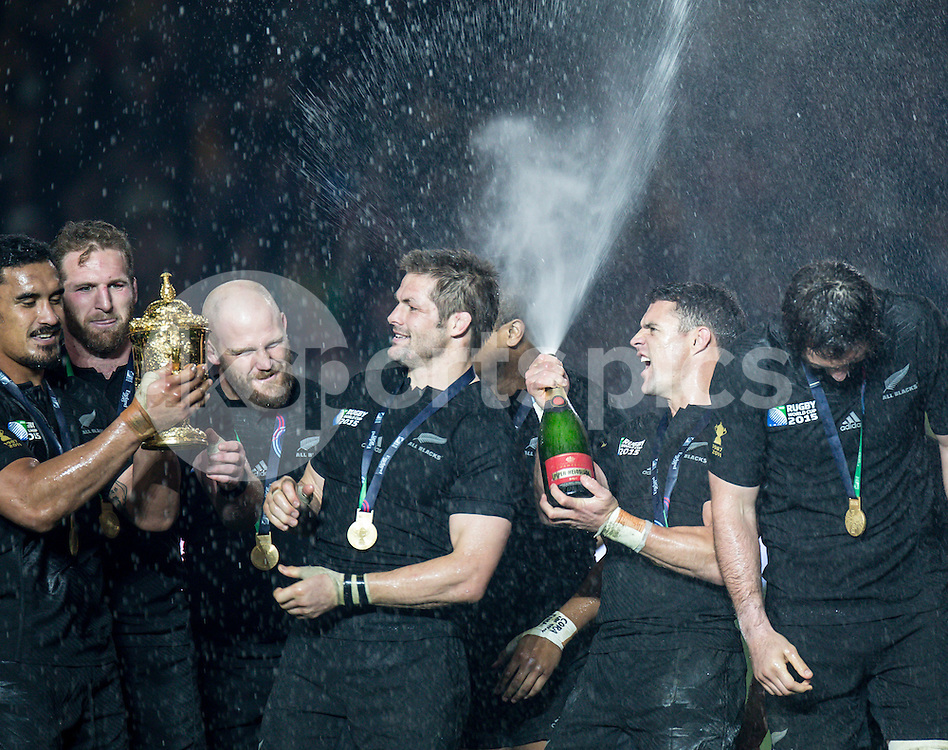 Daniel Carter of New Zealand pops the champagne during the Rugby World Cup Final match between New Zealand and Australia played at Twickenham Stadium, London on the 31st of October 2015. Photo by Liam McAvoy