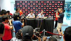 KUALA LUMPUR, MALAYSIA - Friday, July 15, 2011: Liverpool's Martin Kelly and new signing Charlie Adam during a promotional event at the Adidas store at the Mid Valley Shopping Centre on day five of the club's Asia Tour. (Photo by David Rawcliffe/Propaganda)