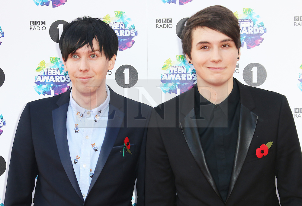 Phil Lester; Dan Howell, BBC Radio 1 Teen Awards, Wembley Arena, London UK, 03 November 2013, Photo by Richard Goldschmidt © Licensed to London News Pictures. Photo credit : Richard Goldschmidt/Piqtured/LNP