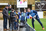 A young Wycombe Wanderers fan takes a selfie with Wycombe Wanderers Goalkeeper Scott Brown (1) ahead of the EFL Sky Bet League 2 match between Wycombe Wanderers and Carlisle United at Adams Park, High Wycombe, England on 3 February 2018. Picture by Stephen Wright.