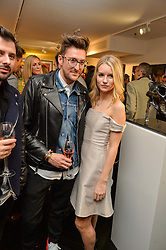 HENRY HOLLAND and LOTTIE MOSS at a party to celebrate the launch of the Maddox Gallery at 9 Maddox Street, London on 3rd December 2015.