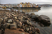 "Barges in the bay, which has 30-foot tides, unload from ships in Iqaluit, Nunavut Territory, Canada. Nearly all supplies come by ship, only during the ice-free spring, summer, and early fall months. Iqaluit, with population of 6,000, is the largest community in Nunavut as well as the capital city. It is located in the southeast part of Baffin Island. Formerly known as Frobisher Bay, it is at the mouth of the bay of that name, overlooking Koojesse Inlet. ""Iqaluit"" means 'place of many fish'. The image is part of a collection of images and documentation for Hungry Planet 2, a continuation of work done after publication of the book project Hungry Planet: What the World Eats, by Peter Menzel & Faith D'Aluisio."