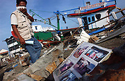 Banda Aceh, Northern Sumatra, Indonesia.<br />Site of the worst destruction of the Boxing day 2004 earthquake and subsequent tsunami.<br />The force odf the tsunami tossed boats on their side and up onto land.