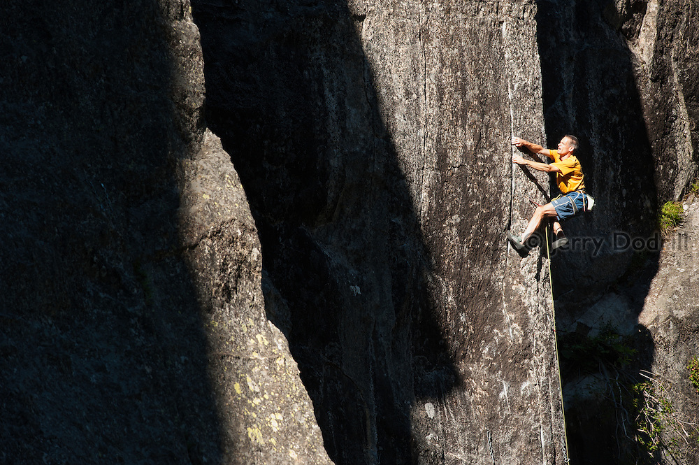 """Tom Addison climbing """"Chains we can Believe in,"""" a 5.12a rock climb at The Lost World on Sonora Pass, Sierra Nevada Mountains, California"""