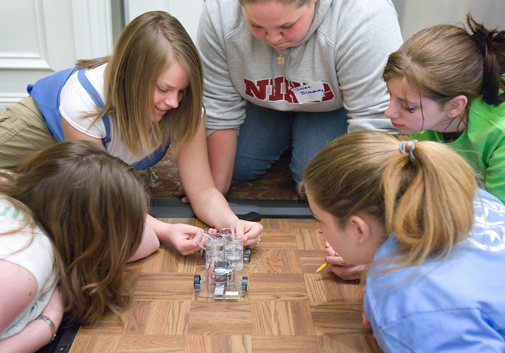 Annie Holbert, (from left), Katie Owen, Jaime Browning, Shonata Lenigar and Kayla Cline work on a battery-powered car during the Russ College of Engineering and Technology research fair/engineering day in the Baker Center ballroom on Thursday, 5/3/07.