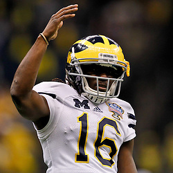 January 3, 2012; New Orleans, LA, USA; Michigan Wolverines quarterback Denard Robinson (16) against the Virginia Tech Hokies during the second quarter of the Sugar Bowl at the Mercedes-Benz Superdome.  Mandatory Credit: Derick E. Hingle-US PRESSWIRE