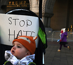 "December 10, 2016 - Washington, DC, USA - DAVID DASCHER sits in stroller with sign saying ''Stop Hate.'' His mother was very excited about a kid-friendly event and brought him from Philadelphia PA. Children's Rally for Kindness takes place at Trump International Hotel in Washington DC on December 10, 2016 organized by the Takoma Parents Action Coalition.  According to their FaceBook page, it was a call to President-elect Donald Trump: ''to remember these lessons as he prepares to take office and implement policies that will affect the lives of children and families across our diverse nation.''.''All over the world, across cultures and countries, children learn the same basic lessons: .Ã'be kind,Ã"" .Ã'tell the truth,Ã"" .Ã'be fair,Ã"" .Ã'respect everyone,Ã"" .Ã'treat others the way you want to be treated,Ã"" .Ã'donÃ•t touch others if they donÃ•t want to be touched. (Credit Image: © Carol Guzy via ZUMA Wire)"