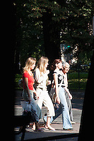Young women walking through the Planty in central Krakow Poland