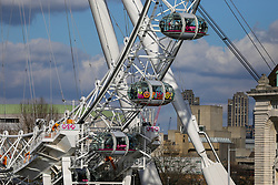"""© Licensed to London News Pictures. 06/03/2020. London, UK. A piece of street art """"LONDON"""" by Ben Eine wraps a pod on London's ferris wheel - The London Eye marks its 20th anniversary next week. Photo credit: Dinendra Haria/LNP"""