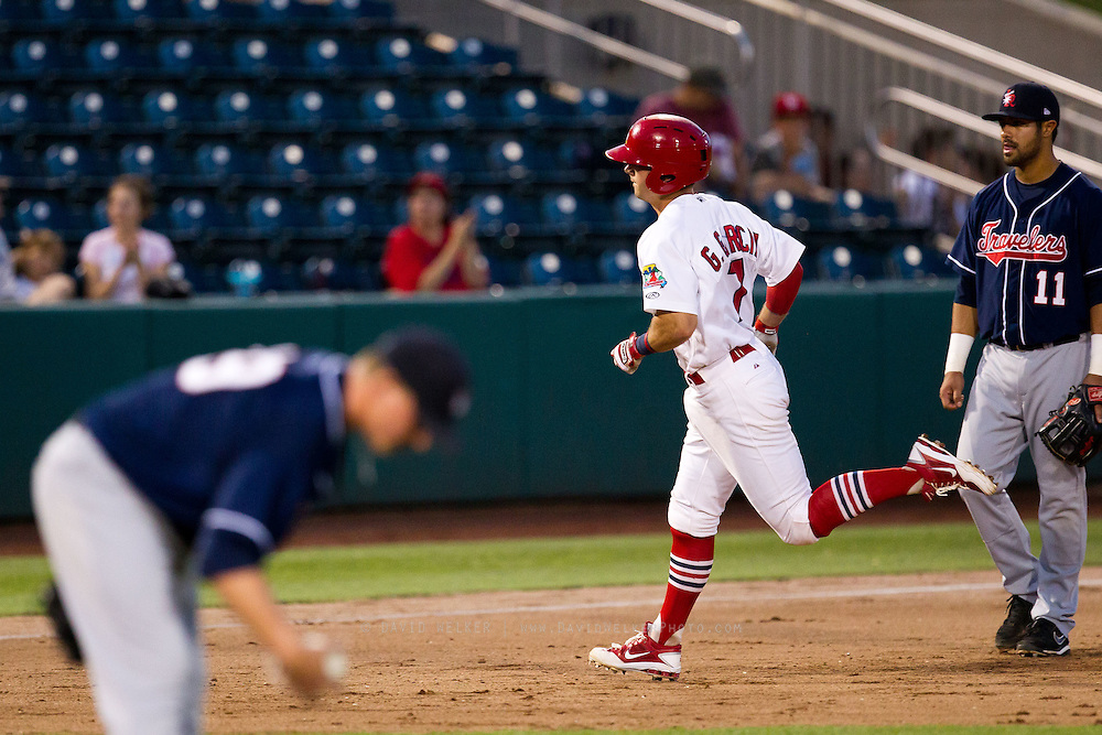 Greg Garcia (7) of the Springfield Cardinals rounds the bases after hitting a home run during a game against the Arkansas Travelers at Hammons Field on July 25, 2012 in Springfield, Missouri. (David Welker/Four Seam Images)
