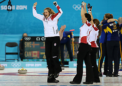 The XXII Winter Olympic Games 2014 in Sotchi, Olympics, Olympische Winterspiele Sotschi 2014<br /> Sochi, Krasnodar Krai, Russia. Canada skip Jennifer JONES and team during the final of the Women's Curling competition from the Ice Cube Curling Centre, Coastal Clustre - XXII Olympic Winter Games