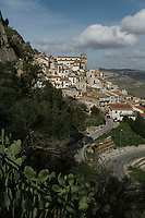 "SUTERA, ITALY - 8 JANUARY 2018: A view of  the ""Rabato"" district in the historical center of Sutera, Italy, on January 8th 2018.<br /> <br /> Sutera is an ancient town plastered onto the side of an enormous monolithic rock, topped with a convent, in the middle of the western half of Sicily, about 90 minutes by car south of the Sicilian capital Palermo<br /> Its population fell from 5,000 in 1970 to 1,500 today. In the past 3 years its population has surged  after the local mayor agreed to take in some of the thousands of migrants that have made the dangerous journey from Africa to the Sicily.<br /> <br /> ""Sutera was disappearing,"" says mayor Giuseppe Grizzanti. ""Italians, bound for Germany or England, packed up and left their homes empty. The deaths of inhabitants greatly outnumbered births. Now, thanks to the refugees, we have a chance to revive the city.""<br />  Through an Italian state-funded project called SPRAR (Protection System for Refugees and Asylum Seekers), which in turn is co-funded by the European Union's Fund for the Integration of non-EU Immigrants, Sutera was given financial and resettlement assistance that was co-ordinated by a local non-profit organization called Girasoli (Sunflowers). Girasoli organizes everything from housing and medical care to Italian lessons and psychological counselling for the new settlers.<br /> The school appears to have been the biggest beneficiary of the refugees' arrival, which was kept open thanks to the migrants.<br /> Nunzio Vittarello, the coordinator of the E.U. project working for the NGO ""I Girasoli"" says that there are 50 families in Sutera at the moment."