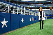 Charlotte Jones Anderson walks through AT&T Stadium in Arlington, Texas on December 12, 2017. (Cooper Neill for The New York Times)