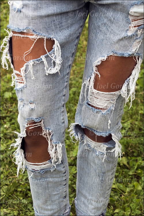 Tattered at the knee, ripped jeans has become a street style fashion statement.<br /> <br /> Did  she ripped them or did they buy them like this?