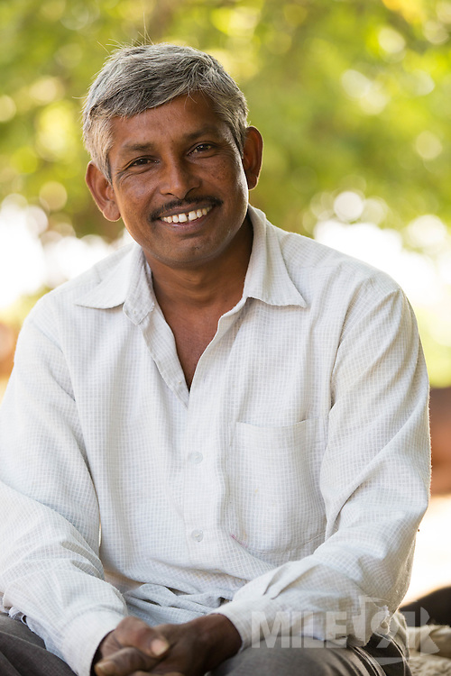 A portrait of Vallabh Bhai Makwana, a farmer in Ahmedabad, India.<br /> <br /> Vallabh has recently installed some drip irrigation on his farm and is seeing some real improvements in his cotton plants but he is also saving water and time.
