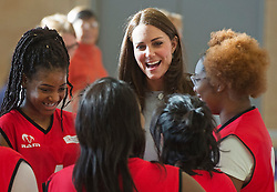 © London News Pictures. 19/01/2015. London, UK. Catherine, Duchess of Cambridge talking to a youth basketball team as she formally opens Kensington Leisure Centre in West London. Photo credit: Ben Cawthra/LNP