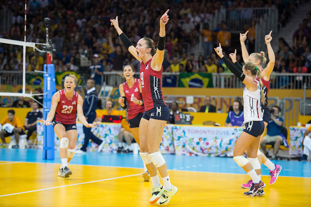 Women's volleyball finals-Kristen Lynn Hidebrand (middle #9) of team USA celebrates with her team-mates, their gold medal victory during competition at the 2015 PanAm Games in Toronto.