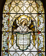 "Stained glass window at St. Katharine Drexel Church in Kaukauna depicts an angel holding a sign that reads ""Blessed are the poor in spirit."" (Photo by Sam Lucero)"