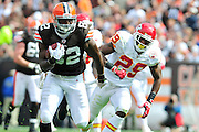 Sept. 19, 2010; Cleveland, OH, USA; Cleveland Browns tight end Benjamin Watson (82) runs from Kansas City Chiefs defensive back Eric Berry (29) during the first quarter at Cleveland Browns Stadium. Mandatory Credit: Jason Miller-US PRESSWIRE