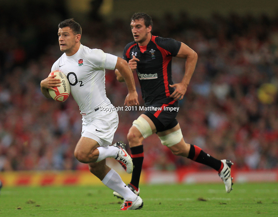 Danny Care of England runs away from Sam Warburton of Wales. Wales v England, Millennium Stadium, Cardiff, Rugby Union, 12/08/2011 © Matthew Impey/Wiredphotos.co.uk. tel: 07789 130 347 email: matt@wiredphotos.co.uk