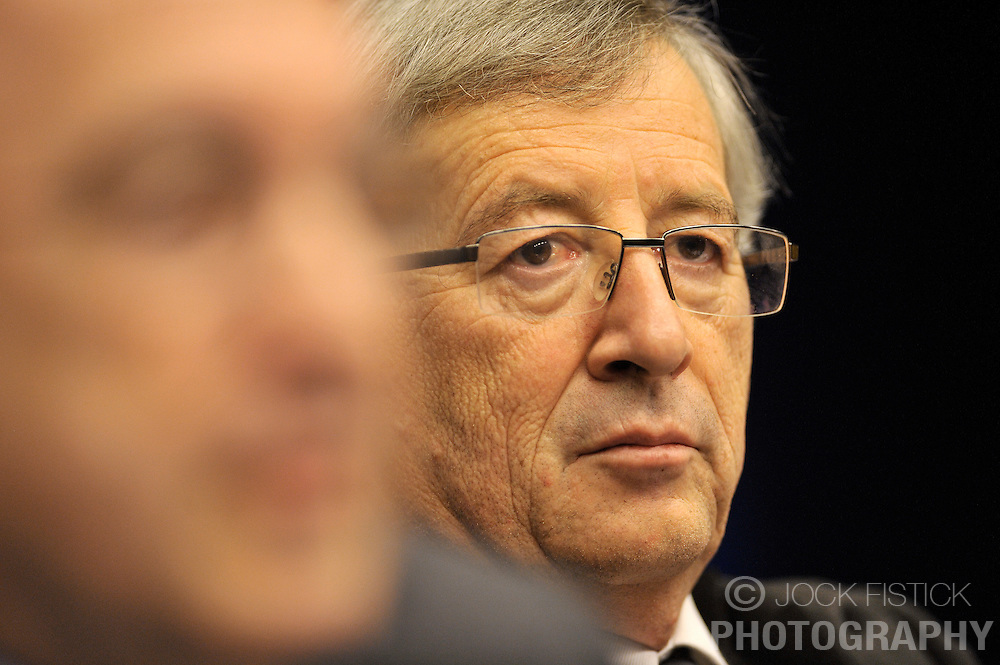 Jean-Claude Juncker, Luxembourg's prime minister, and president of the Eurogroup, listens as Joaquin Almunia, The EU's commissioner for economic and monetary affairs, speaks, during the news conference following Eurogroup, the meeting of finance ministers from the 16 euro-zone countries of the European Union, at the EU Council headquarters on Tuesday, Dec. 1, 2009, in Brussels, Belgium. (Photo © Jock Fistick)