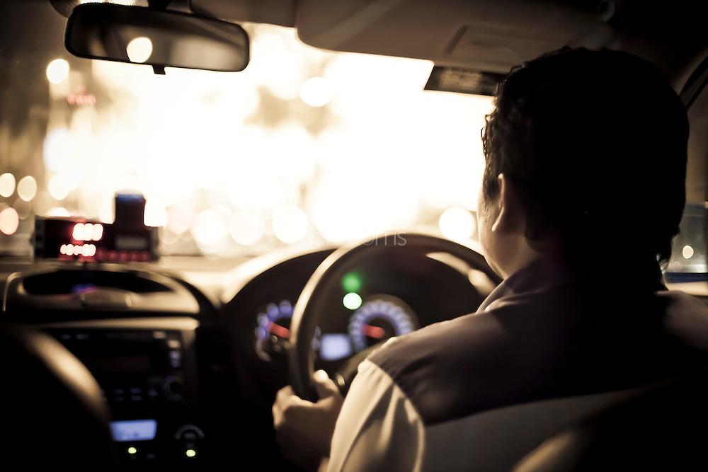 Taxi driver in downtown Kuala Lumpur