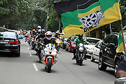 Bikers flying an ANC flag ride past the Nelson Mandela Foundation Centre of Memory in Houghton. They were  amongst thousands of people who came from all walks of life to pay respect to the  former president Nelson Mandela outside his Houghton home, Johannesburg. Scores of people  brought flowers and lit candles in memory of the fallen hero. Mandela died on the December 5 in his Houghton home.<br /> ©Exclusivepix