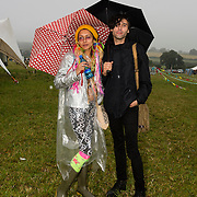 Young couple in heavy rain at Farm Fest Bruton, Somerset.