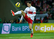 Robert Lewandowski of Poland controls the ball during the 2014 World Cup Qualifying Group H soccer match between Poland and San Marino at National Stadium in Warsaw on March 26, 2013...Poland, Warsaw, March 26, 2013...Picture also available in RAW (NEF) or TIFF format on special request...For editorial use only. Any commercial or promotional use requires permission...Photo by © Adam Nurkiewicz / Mediasport