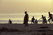 Crowds on Dakar Beach wait for the fishing boats to return - Senegal