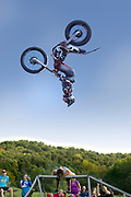 Stunt motorcycle man jumps over a woman at the Single Track Mind Festival in Missouri. Photo by Brandon Alms Photography