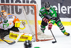12.02.2015, Hala Tivoli, Ljubljana, SLO, EBEL, HDD Telemach Olimpija Ljubljana vs Moser Medical Graz, 2. Qualification Round, in picture Danny Sabourin (Moser Medical Graz 99ers, #35) and Andrej Hebar (HDD Telemach Olimpija, #84) during the Erste Bank Icehockey League 2. Qualification Round between HDD Telemach Olimpija Ljubljana and Moser Medical Graz 99ers at the Hala Tivoli, Ljubljana, Slovenia on 2015/02/12. Photo by Morgan Kristan / Sportida
